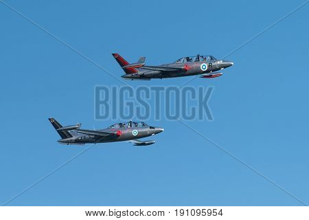 HELSINKI, FINLAND - JUNE 9: Two Silver Jets Aerobatic Team Fouga CM 170 Magister jets flying at the Kaivopuisto Air Show June 9, 2017 in Helsinki, Finland.