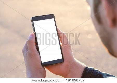 Man Uses His Mobile Phone Outdoor