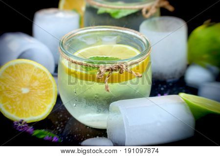 Soft and selective focus on lemon juice with ice in glass - your enjoyment of refreshment