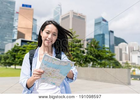 Young woman use of map in Hong Kong
