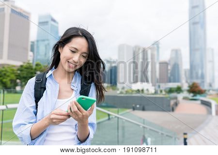 Woman use of mobile phone in Hong Kong city