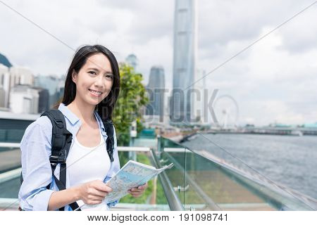 Woman checking on city map in Hong Kong