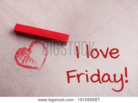 Pastel chalk, red heart and text I LOVE FRIDAY on paper background
