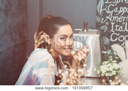 Portrait of happy young women coffee shop owner