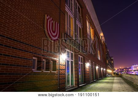 The university of Bremen at the river at night