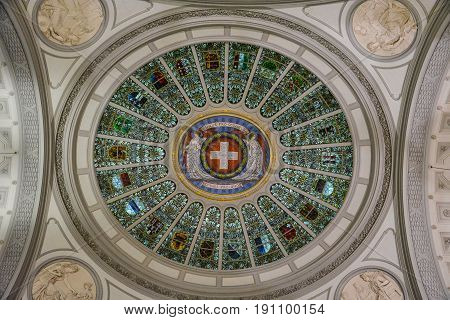 The Swiss Flag and emblems of all cantons of Switzerland on the ceiling in the