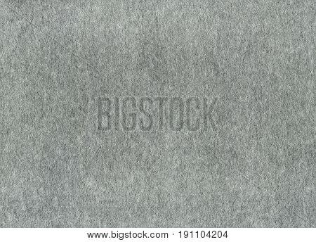 abstrakt background of dark gray felt close-up