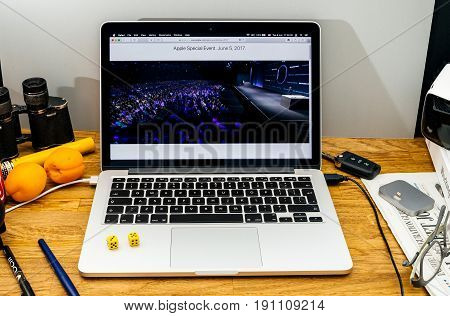 PARIS FRANCE - JUNE 6 2017: Apple Computers website on MacBook laptop in creative environment showcasing news from Apple at WWDC 2017 - large auditorium