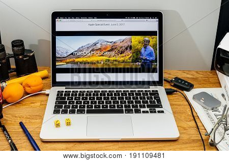 PARIS FRANCE - JUNE 6 2017: Apple Computers website on MacBook laptop in creative environment showcasing Apple Craig Federighi previews macOS High Sierra at WWDC 2017 - presentation of new name