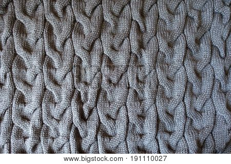Gray Knitted Fabric With Plait Pattern From Above