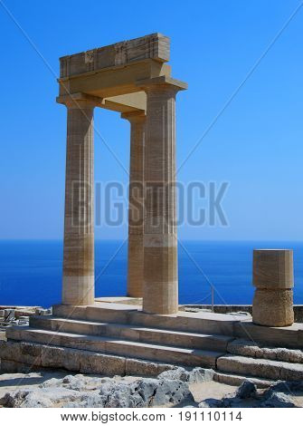 the acropolis in lindos rhodes with blue sky and sea in summer