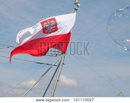 Polish flag. Gdynia, Poland - June 11, 2017 Polish flag on the mast of the battleship ORP