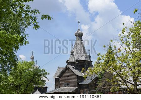 Merchant Izba In Russia And Church Wood