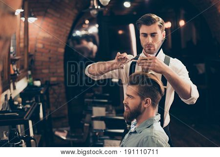 Profile View Of A Red Bearded Stylish Barber Shop Client. He Is Getting His Perfect Trendy Haircut F