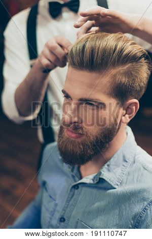 Close Up Cropped Photo Of A Barber Shop Classy Dressed Stylist, Who Is Doing A Perfect Hairstyle To