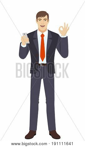 Businessman with mobile phone showing a okay hand sign. Full length portrait of businessman character in a flat style. Vector illustration.