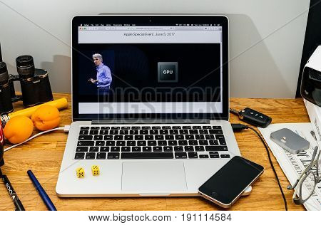 PARIS FRANCE - JUNE 6 2017: Apple Computers website on MacBook laptop in creative environment showcasing Apple Craig Federighi previews macOS High Sierra at WWDC 2017 - new gpu in laptops for better rendering