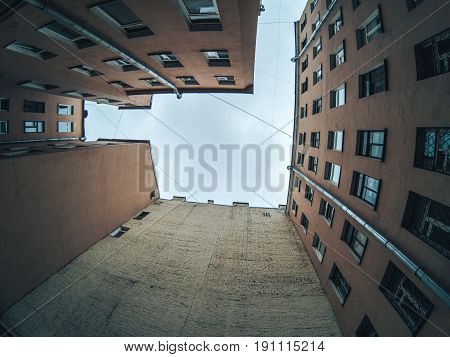 Look up from the courtyard of the well, town houses in St. Petersburg, frame