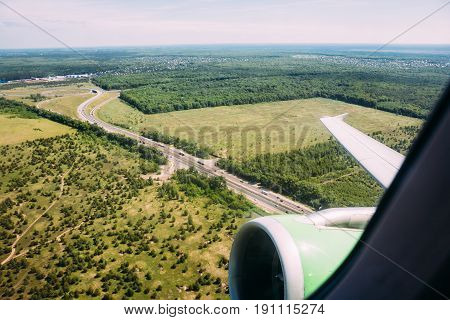 Green earth and plane wing view from an illuminator of plane