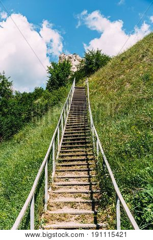 Man-made staircase upstairs to the hill with green grass, travel and tourism concept, Divnogorie, Voronezh region vertical image