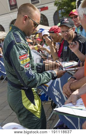 LE MANS FRANCE - JUNE 11 2017: Danish race car driver Marco Sorensen Aston Martin Racing gives autograph Weighing administrative and technical checks of the cars for competition 24 hours Le mans