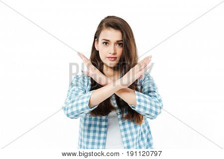 Young pretty brunette girl cross her arms to show gesture no isolated over white
