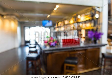 Abstract Blur Background of Bar Counter for Alcohol Beverages in Cafeteria or Pub Restaurant as Hipster Lifestyle Concept