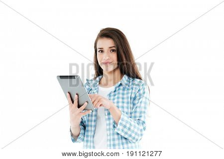 Portrait of a smiling young girl using tablet computer isolated over white background