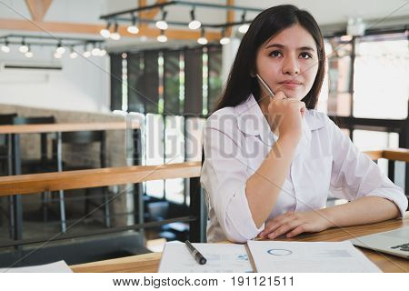 Businesswoman Using Laptop Computer At Workplace. Young Female Entrepreneur Woman Working With Busin