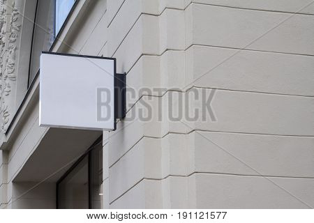 horizontal front view of empty white square signage on a building with classical architecture