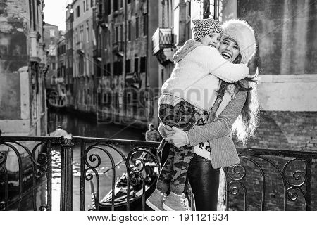 Mother And Daughter Tourists In Venice, Italy In Winter Hugging