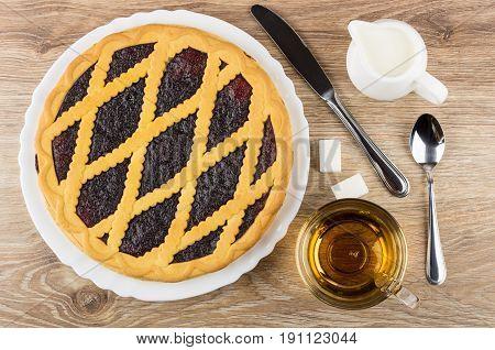 Bilberry Pie In White Dish, Jug Of Milk, Knife, Tea