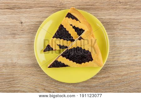 Two Pieces Of Bilberry Pie In Yellow Saucer On Table