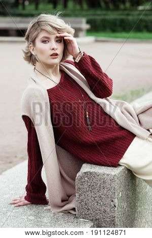 Young beautiful woman. Glamour fashion portrait. Autumn park.