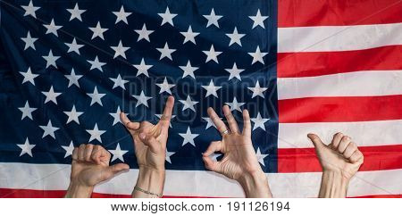 The Hands Of The Crowd On The Backdrop Of The American Flag,
