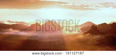 Red Misty Daybreak In A Beautiful Hills. Peaks Of Hills Are Sticking Out From Foggy Background,  Red