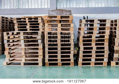 The pallets inside warehouse for support product or materiel and equipment.
