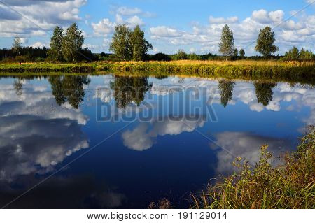 Summer landscape, river and clouds in coast scenery
