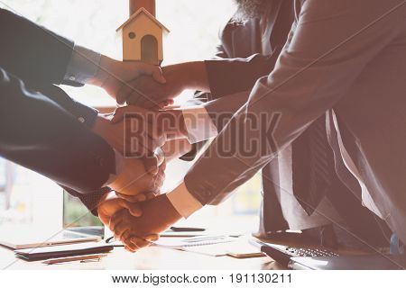House Developer And Businessman Shaking Hands After Finishing Up A Business Meeting. Architect And E