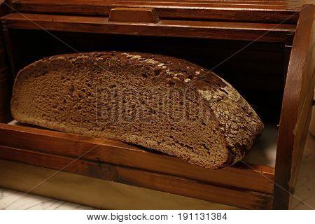 Half Of Black Rye Artisan Bread Loaf