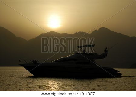Yacht Silhouette In The Mountains