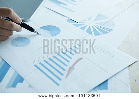 Businessman Analyze Market Chart At Workplace. Young Male Entrepreneur Woman Working With Business D