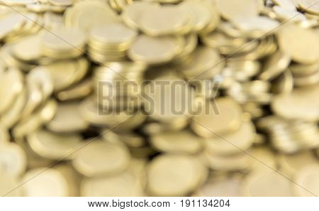 Background of coins. Many coins. Out of focus