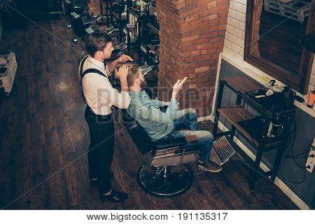 Top View Of Barber Shop Classy Dressed Stylist, Who Is Working For A Perfect Hairdo Of A Blond Beard