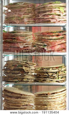 Lots Of Stuffed Sandwiches Called Spianata Or Piadina In Italian