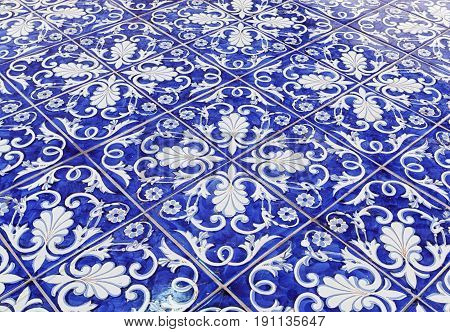 Tile texture background with blue majolica .