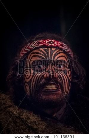 NORTH ISLAND, NEW ZEALAND- MAY 17, 2017: Portrait of Tamaki Maori leader man with traditionally tatooed face in traditional dress at Maori Culture, Tamaki Cultural Village, Rotorua, New Zealand.