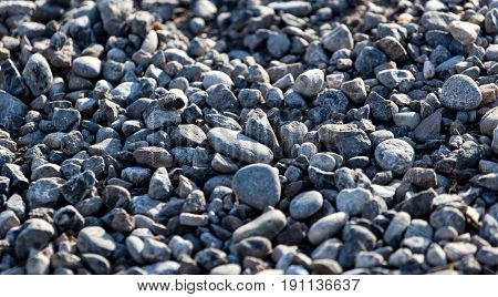 Crushed stone on the road as a background .