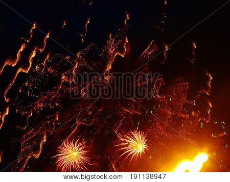 Yellow and red fireworks explosion during the night time.