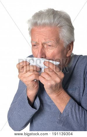 Portrait of coughing senior man isolated on white background